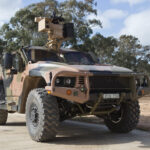 A 'Hawkei' Protected Mobility Vehicle–Light fitted with an Electro Optic Systems RS400 Mk2 Remote Weapon System during a live-fire integration activity at the Department of Defence's Proof and Experimental Establishment-Graytown.